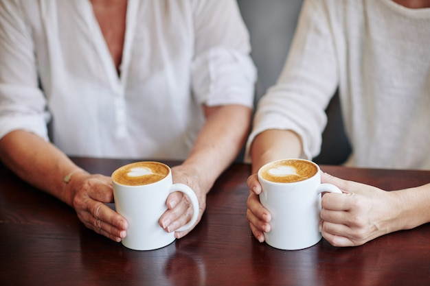 Mother and daughter drinking cappuccino