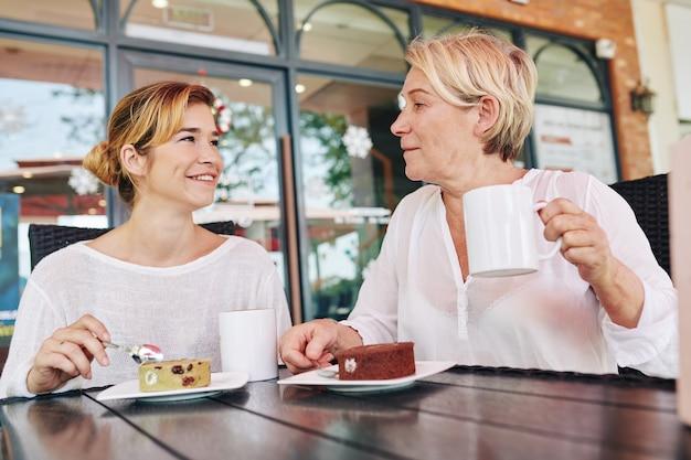 Mother and daughter enjoying conversation