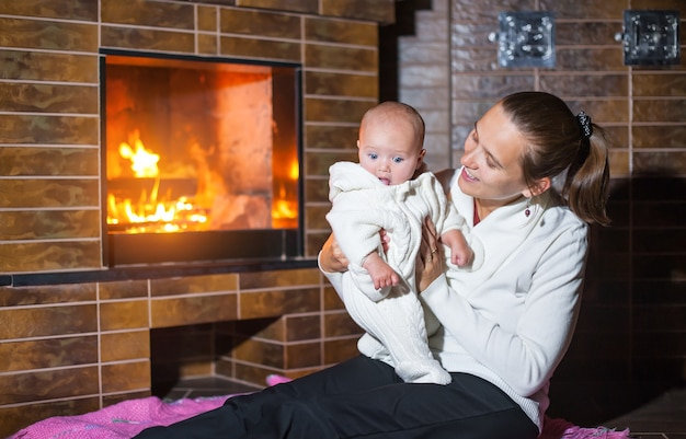Mother and daughter at the fireplace.