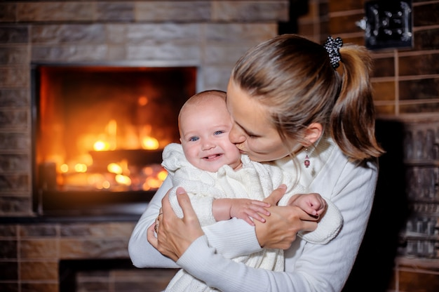 Mother and daughter at the fireplace
