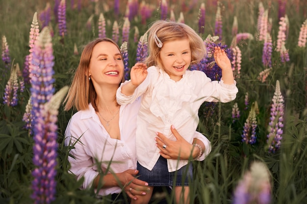 Mother and daughter in floral field