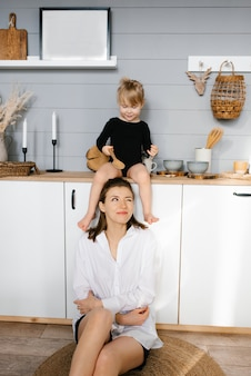 Mother and daughter have fun with wooden spoons