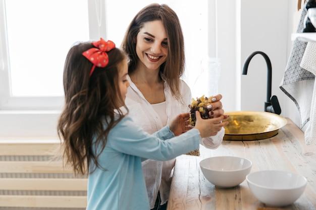 Mother and daughter having breakfast