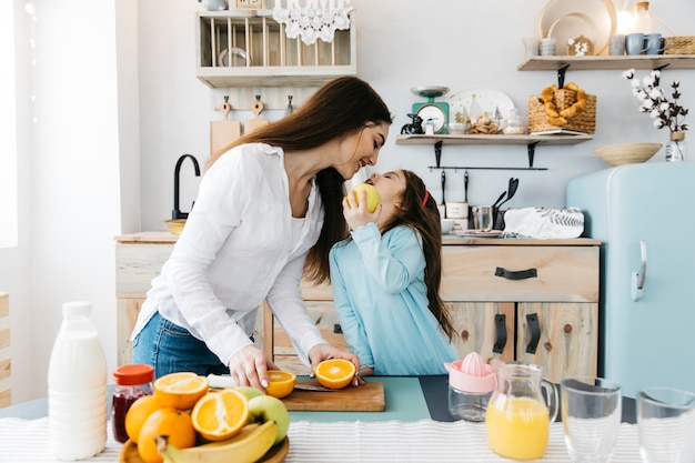Mother and daughter having breakfast