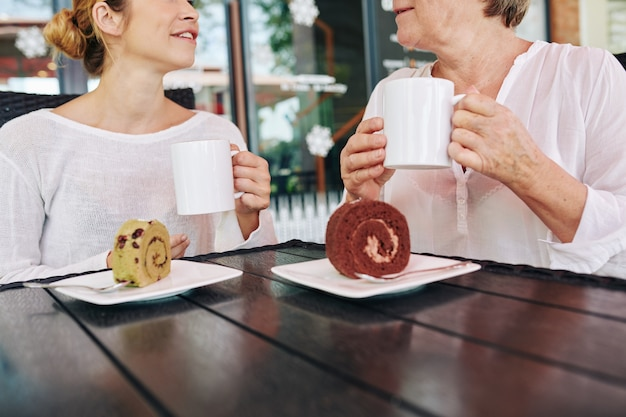 Mother and daughter having desserts