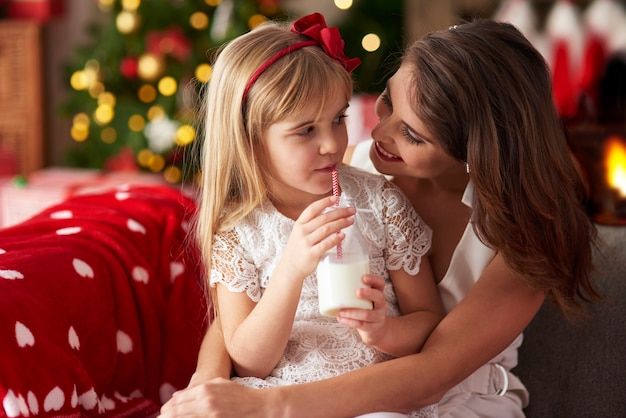 Mother and daughter at home for christmas holidays