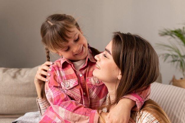 Mother and daughter at home hugging