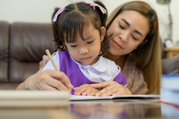 Mother and daughter do homework teaching