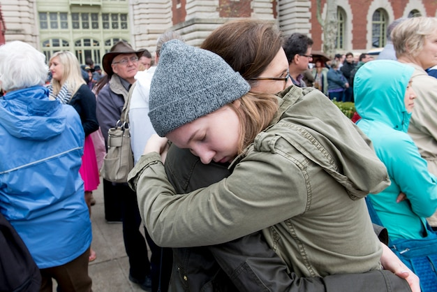 Mother and daughter hugging, ellis island, jersey city, new york state, usa