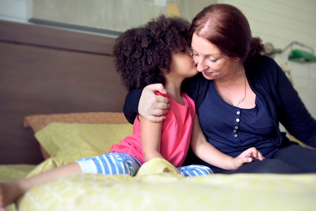 Mother daughter kissing love family concept