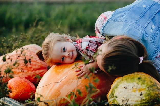 Mother and daughter listening to pumpkins