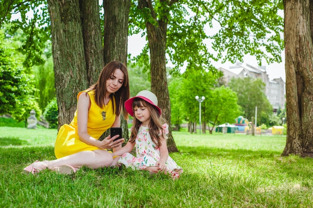 Mother and daughter looking at mobile