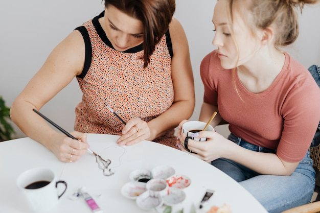 Mother and daughter making art together