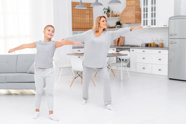 Mother and daughter making fitness exercises