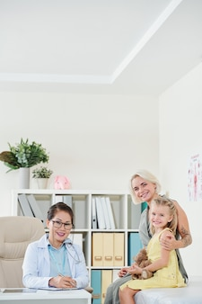 Mother and daughter in office of pediatrician