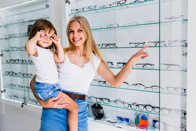 Mother and daughter at optician shop