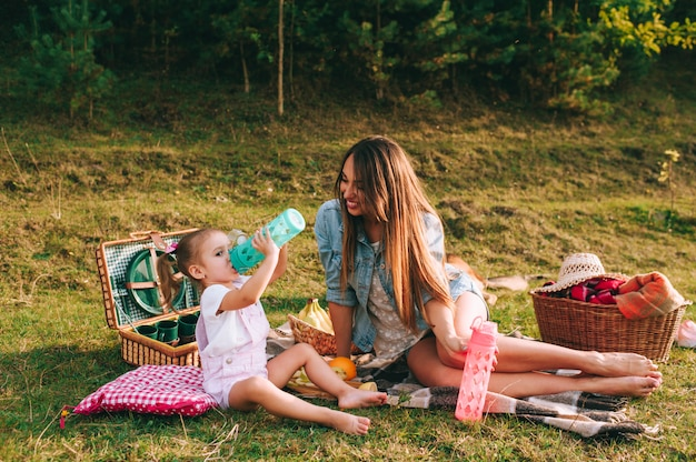 Mother and daughter on picnic