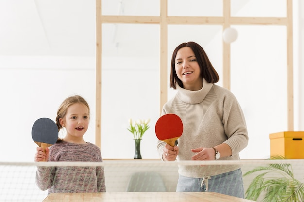 Mother and daughter playing ping pong