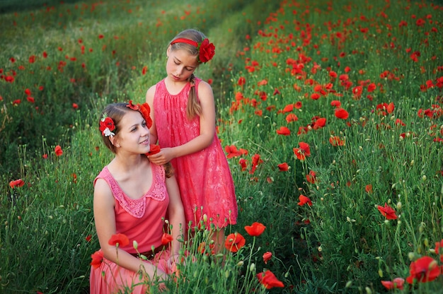 Mother an daughter in poppy field