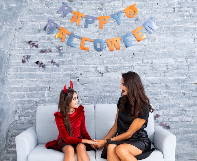 Mother and daughter posing for halloween