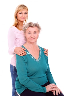 Mother and daughter posing on white