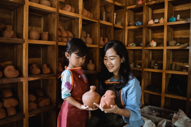 Mother and daughter pottery workshop