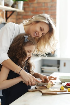 Mother and daughter preparing breakfast