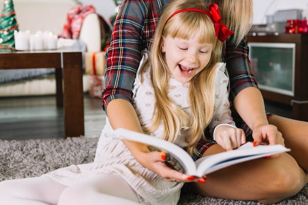 Mother and daughter reading at christmas
