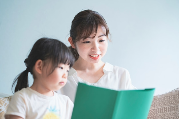 Mother and daughter reading a picture book