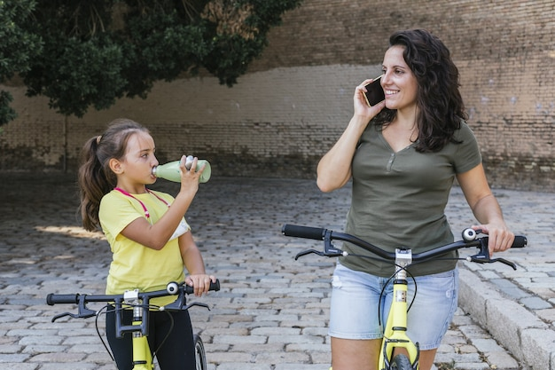 Mother and daughter riding their bicycles