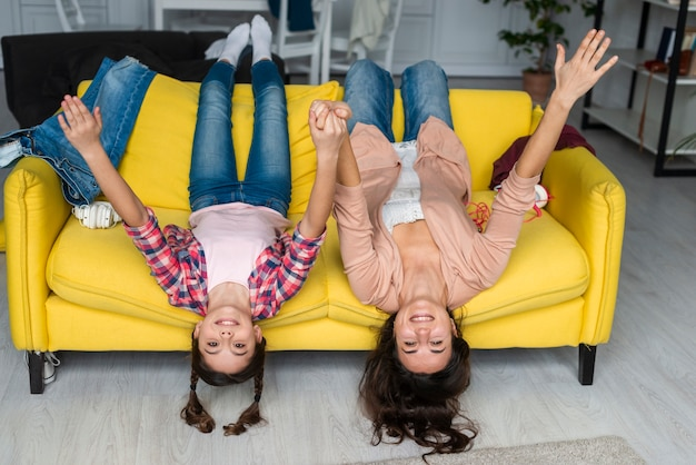 Mother and daughter sitting upside down