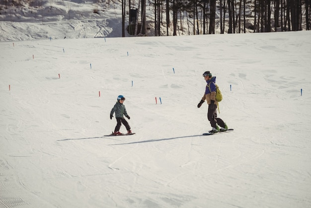Mother and daughter skiing on snowy alps