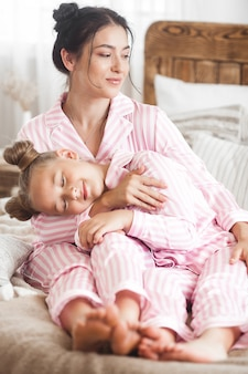 Mother and daughter sleeping cute child in pajamas