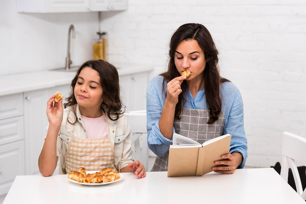Mother and daughter spending time together in the kitchen