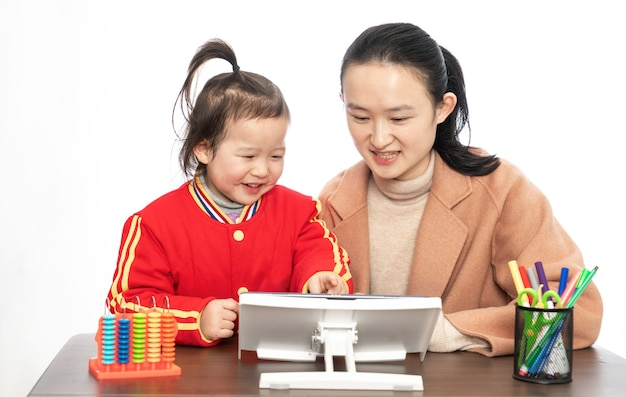 Mother and daughter study online class with tablet computer