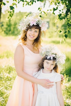 Mother and daughter in the summer outdoors
