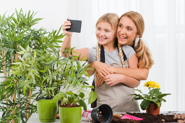 Mother and daughter taking selfies