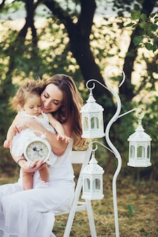 Mother and daughter together in garden outdoors