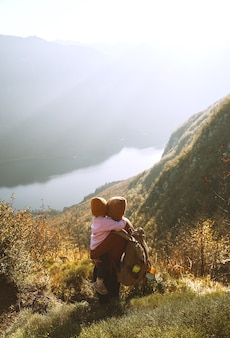 Mother and daughter together outdoors adventure travel with kids in nature