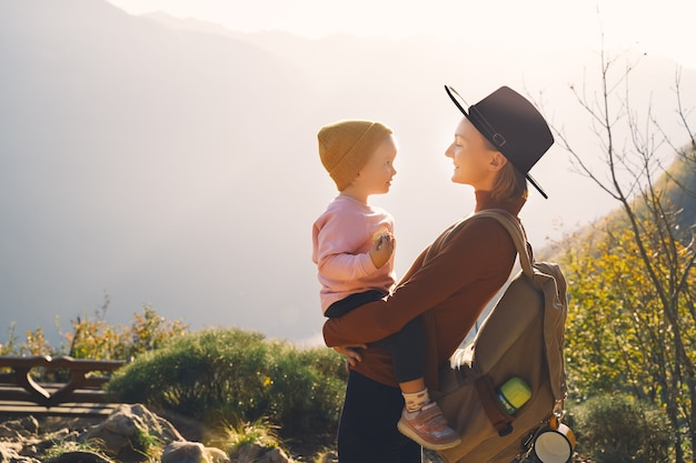 Mother and daughter together outdoors beautiful happy family on a hike in nature