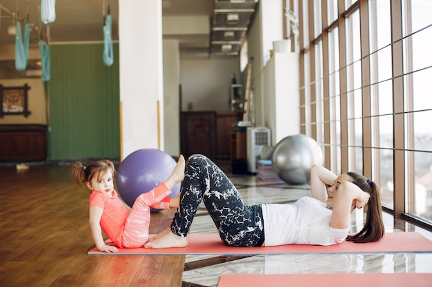 Mother and daughter training in a gym