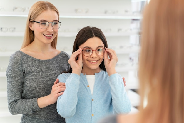 Mother and daughter trying on glasses