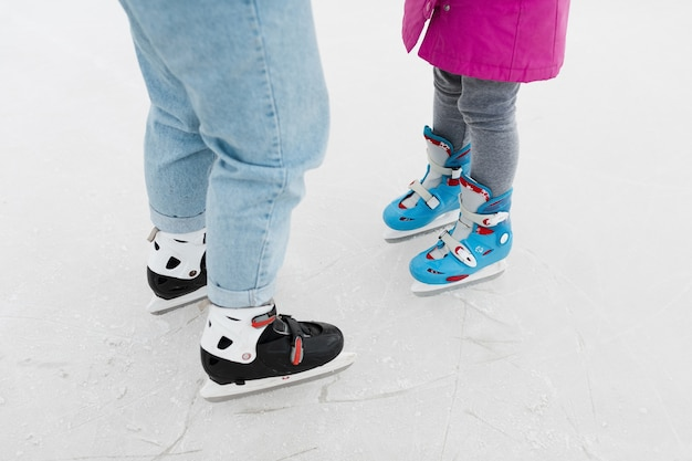 Mother and daughter wearing ice skates