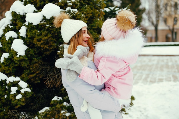 Mother and daughter in a winter park