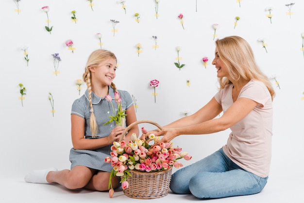 Mother and daughter with basket flowers