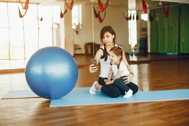 Mother and daughter with fitball
