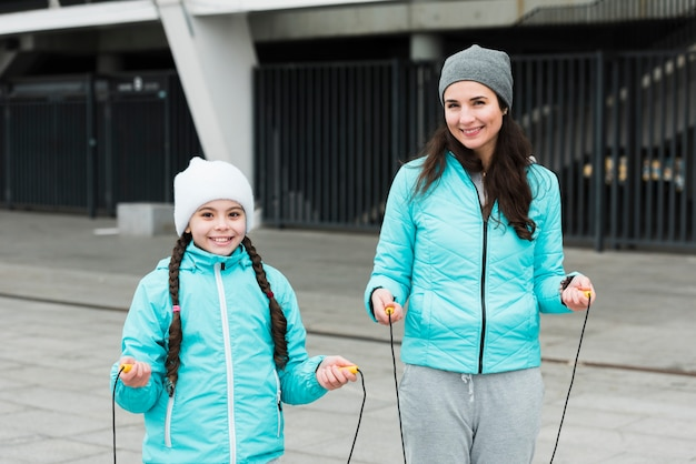 Mother and daughter with jumping rope