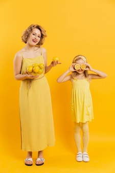 Mother and daughter with lemons