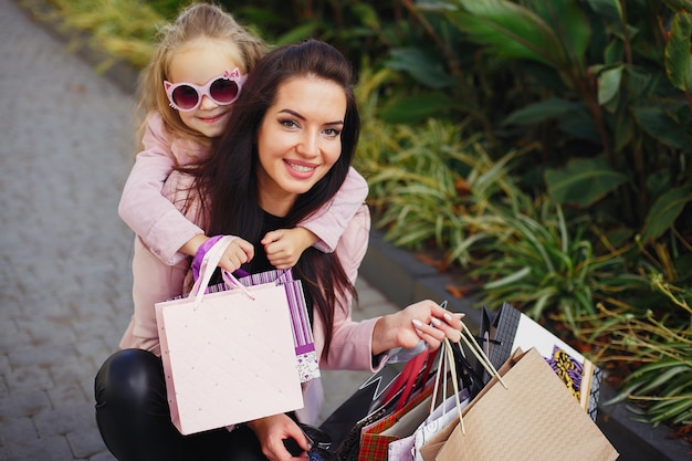 Mother and daughter with shopping bag in a city