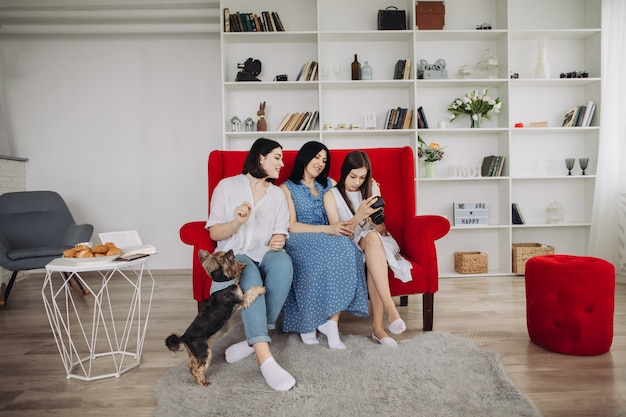 Mother and daughters resting in the living room